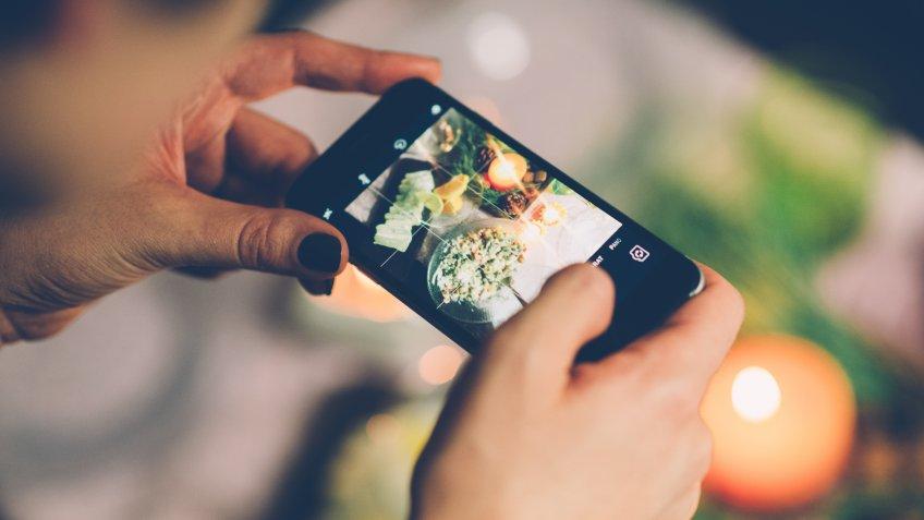woman taking social media content