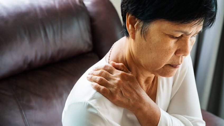 neck and shoulder pain, old woman suffering from neck and shoulder injury, health problem concept.
