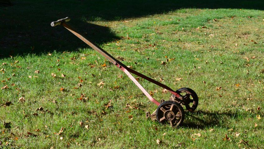 A very old reel type lawn mower - Image.