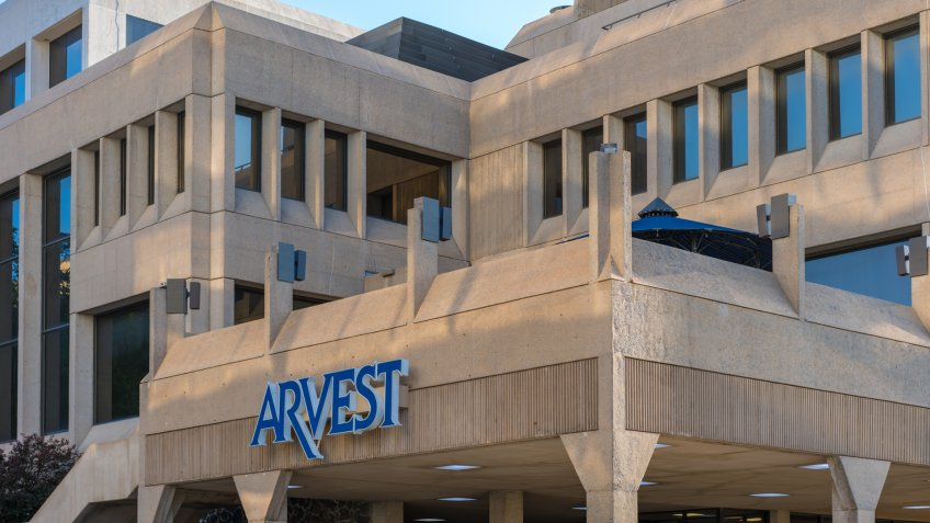 Fayetteville, Arkansas / USA - May 04 2019: Arvest Bank building downtown Fayetteville, Northwest Arkansas, Arkest blue sign - Image.