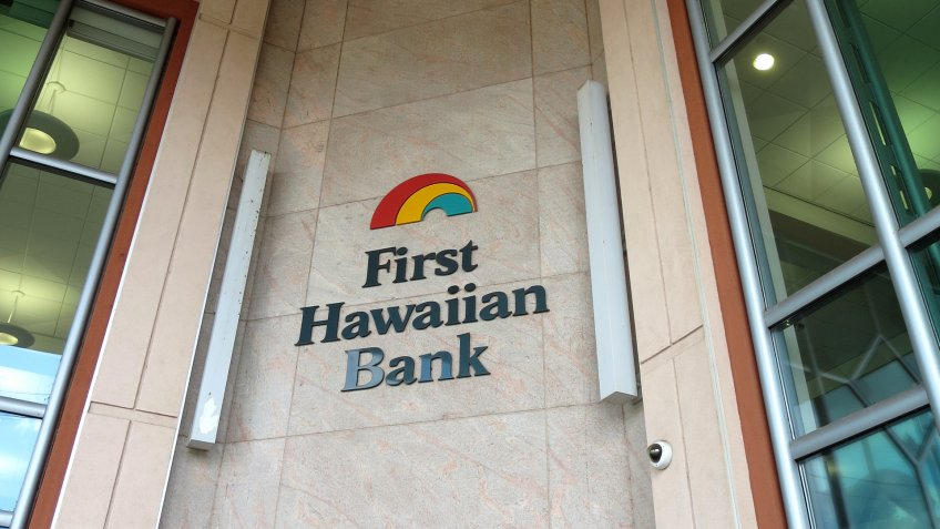 HONOLULU - APRIL 3: First Hawaiian Bank logo on side of Building in Honolulu, Hawaii April 3, 2014.