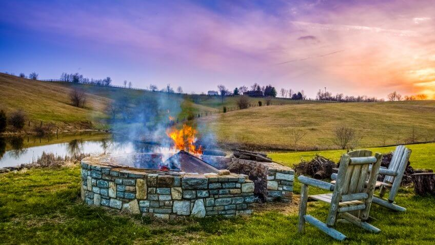 Bonfire in a fire pit at sunset in Central Kentucky countryside - Image.