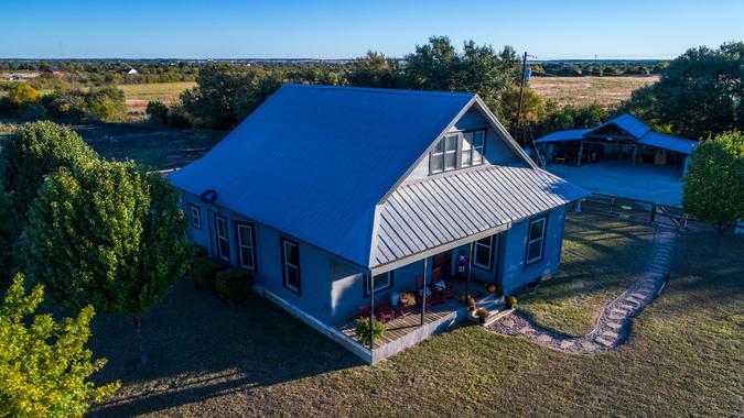 Open Ranch Farm lands large acre lot with Cozy quaint historic Home built in the 1900's in Georgetown , Texas Perfect corner shot from the top of the house - Image.