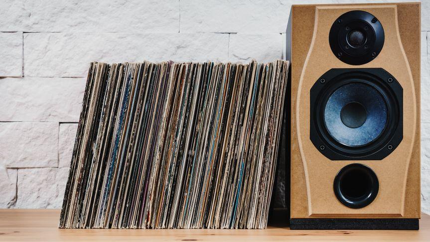 wooden shelf full of old vinyl records and speaker - Image.