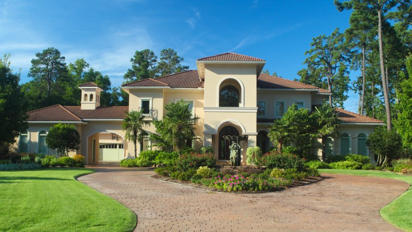 Luxury home exterior under early morning light.