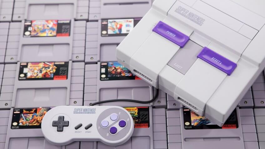 Taipei, Taiwan - June 19, 2019: A Nintendo SNES system and controller on top of cartridges - Image.