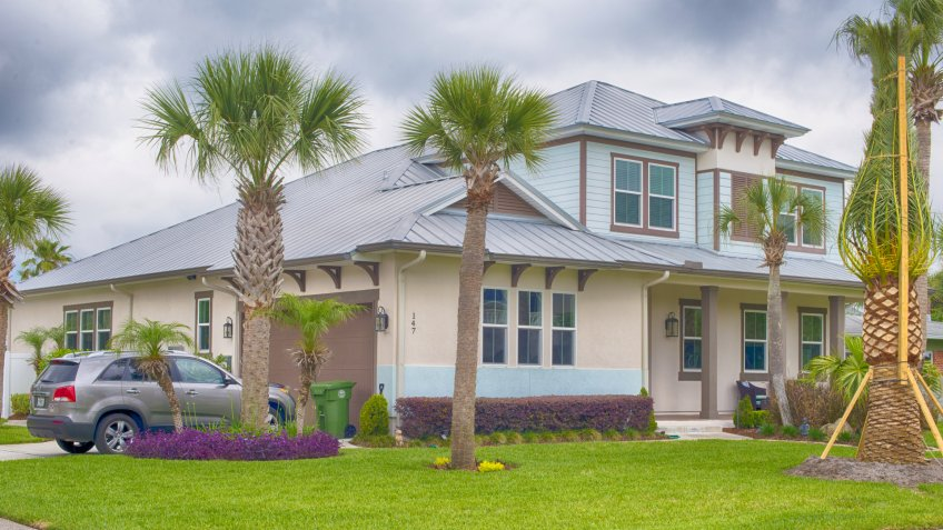 Jacksonville Florida, USA - MAY 04, 2016: Custom built luxury house with nicely trimmed front yard, lawn in a residential neighborhood.