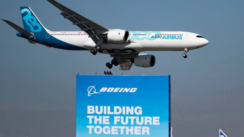 Airbus A330 Neo flies over Boeing sign at 53rd International Paris Air Show