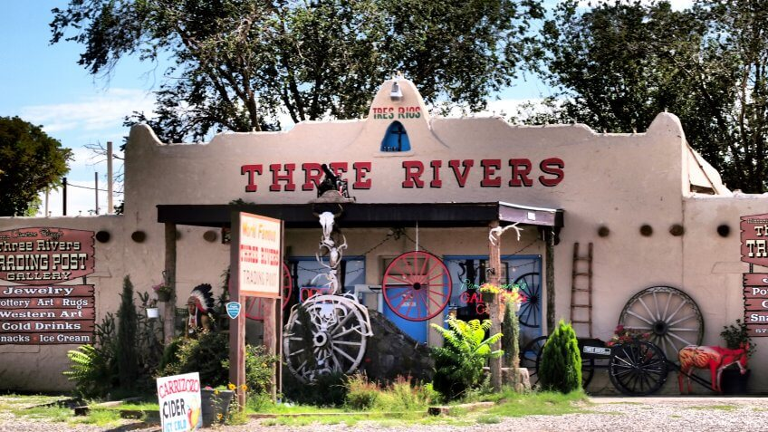 Alamogordo, United States - August 16, 2011: Three rivers trading post, with trees and blue sky in background.