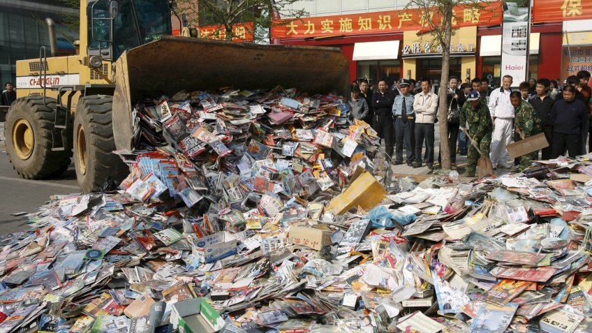 Chinese law enforcement destroy pirated DVDs