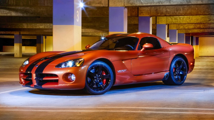 """""""Thousand Oaks, California USA - September 11,2011: Dodge Viper SRT10 orange with black stripes, profile low angle shot, photographed in the a parking garage with flashes and spot lights."""