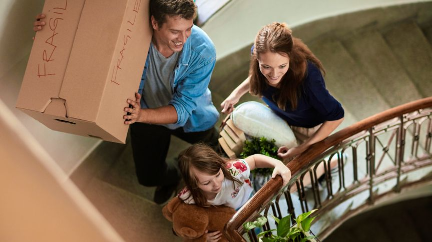 Close up of a young family moving home.