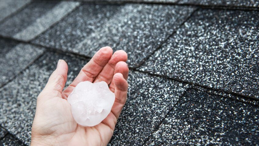 Hail in hand on a rooftop after hailstorm - Image.