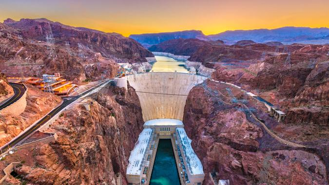 Hooover Dam on the Colorado River straddling Nevada and Arizona at dawn.