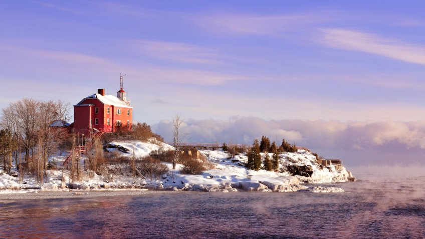 The Historic Marquette Harbor Lighthouse On Lake Superior, Michigan's Upper Peninsula in winter.