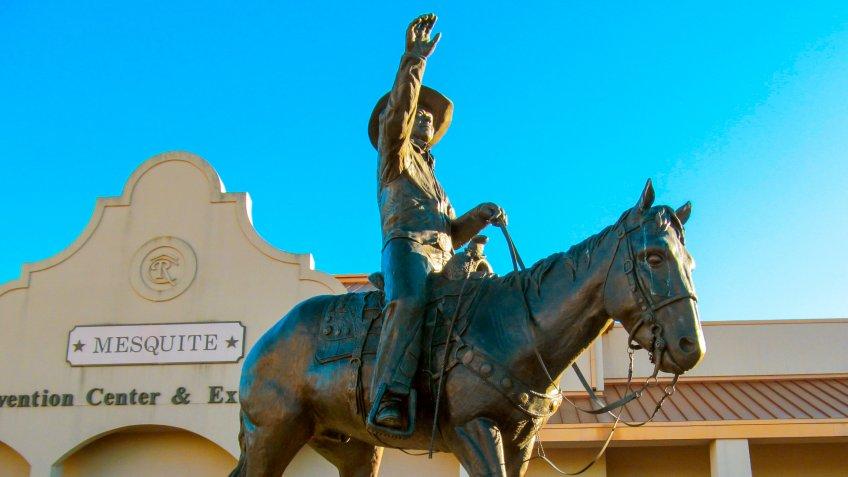 Dallas, TX, USA, October, 29, 2017: Statue of cowboy on horse near Mesquite Arena.