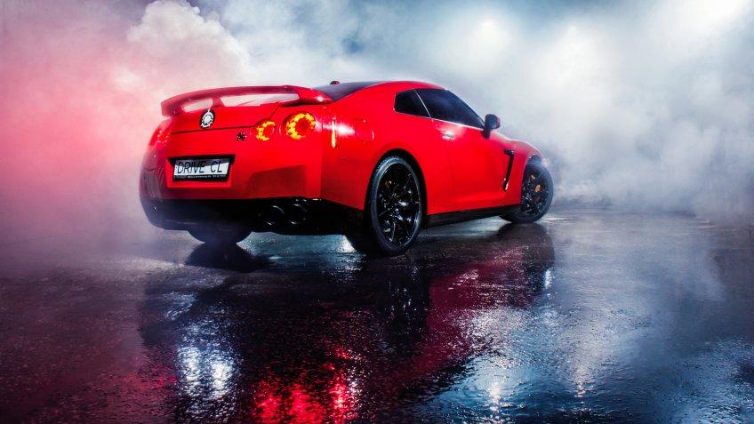 Vinnitsa, Ukraine - 08 december 2013: Red sport car Nissan GTR - in the road - Image.