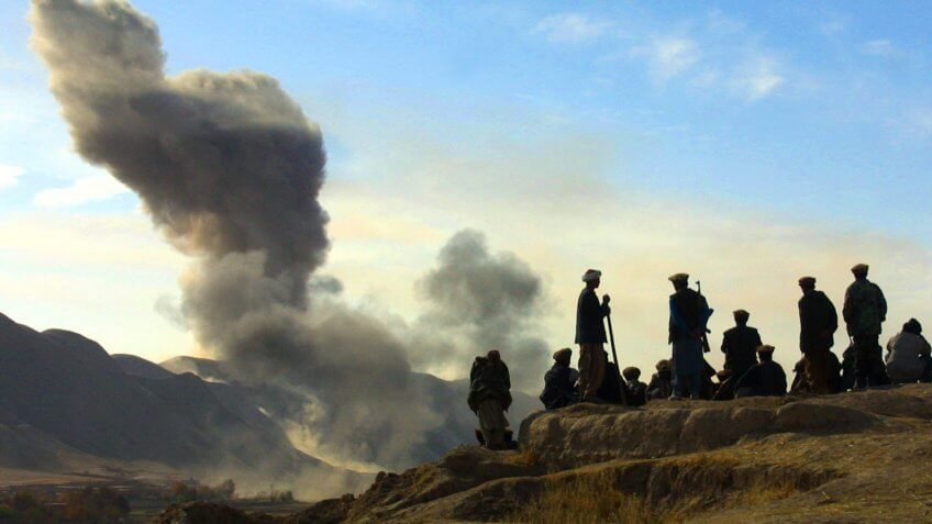 Northern Alliance soldiers watch as US air strikes pound Taliban in Afghanistan