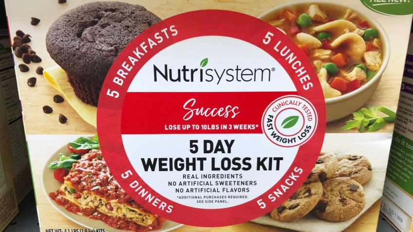 New Hope, Minnesota - May 26, 2019: Nutrisystem brand 5-day weight loss dieting kit, complete with all the meals, sits on a grocery store shelf - Image.