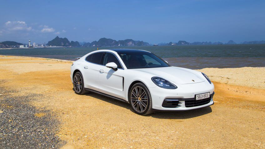 Halong, Vietnam - May 30, 2017: Porsche Panamera 4S 2017 car on the test road in test drive in Vietnam.