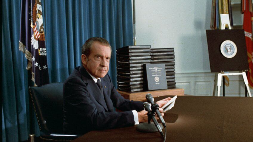 President Nixon with his edited transcripts of the White House Tapes subpoenaed by the Special Prosecutor, during his speech to the Nation on Watergate.