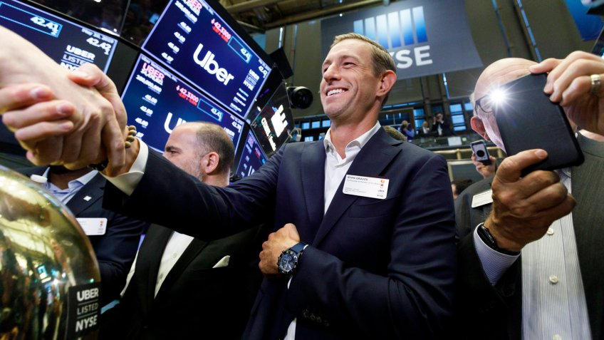 Mandatory Credit: Photo by JUSTIN LANE/EPA-EFE/Shutterstock (10233953ae)Ryan Graves (C), one of the co-founders of Uber, celebrates today's initial public offering for Uber at the New York Stock Exchange in New York, New York, USA, 10 May 2019.