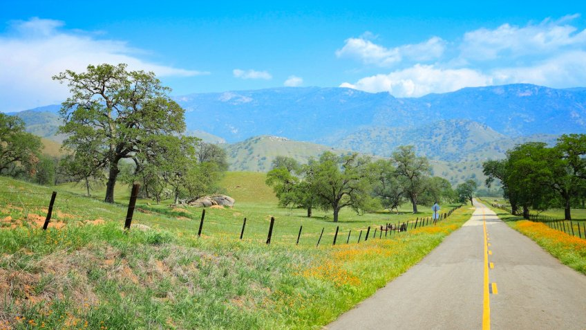 California, United States - winding road in countryside landscape of Tulare County.