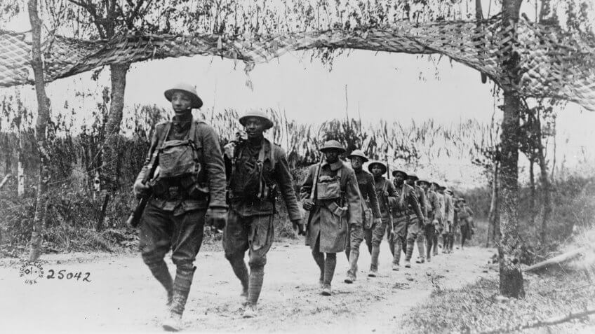 U.S. Army Infantry troops, African American unit, marching northwest of Verdun, France, in World War I