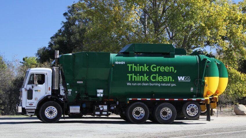 California, USA, Nov 16, 2015: Green vacuum truck near a tree - Image.