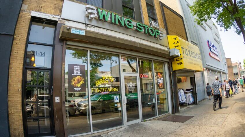 New York NY/USA-May 27, 2019 WingStop fast food on busy Steinway Street in the Astoria neighborhood of Queens - Image.