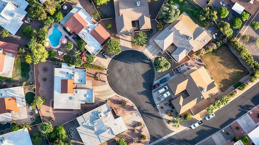 Aerial view looking directly down on a cul-de-sac in a planned exclusive residential community in the Scottsdale area of Arizona.