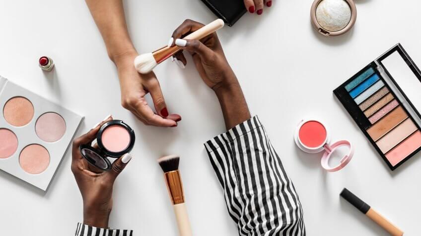 Beauty blogger testing cosmetics.