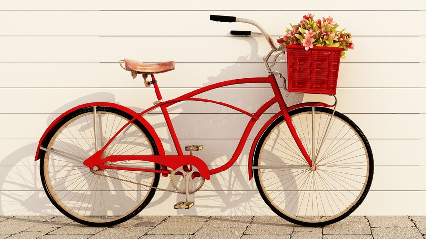 red retro bicycle with basket and flowers.