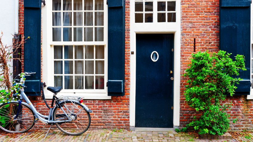 Bike in Front of a Brick Facade of the Old Dutch House - Image.