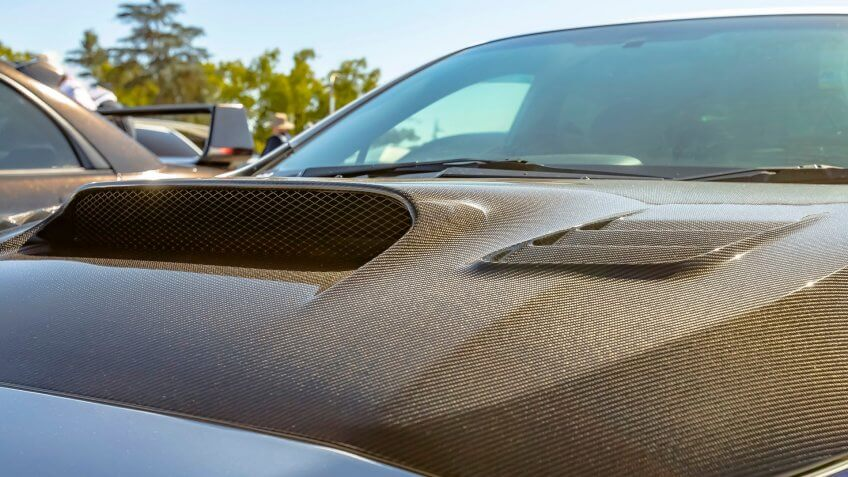 Carbon fiber hood of a silver car on a sunny day - Image.