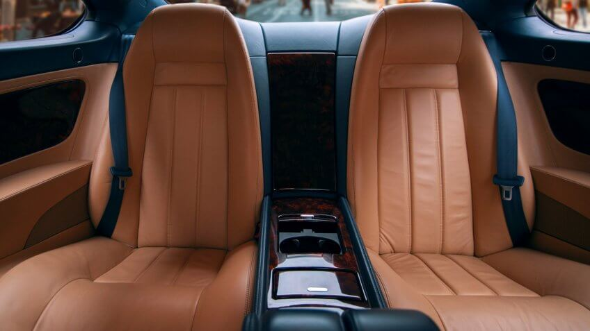 Rear leather seats of business car, interior.
