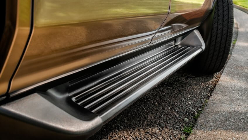 Running Board of Sport Utility Vehicle, close-up.