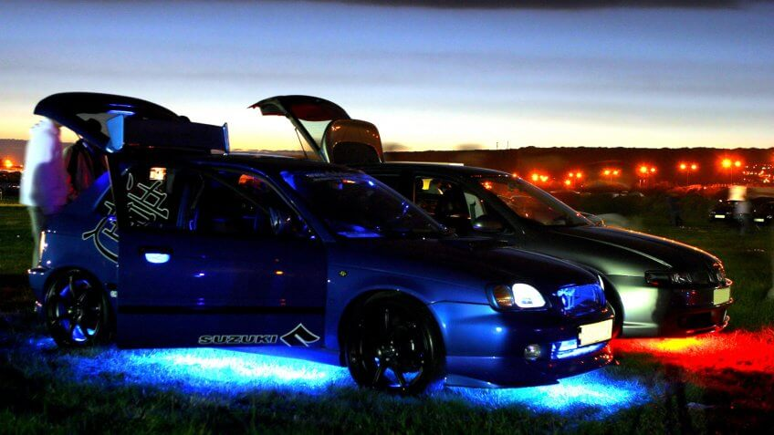 car with neon under body lights