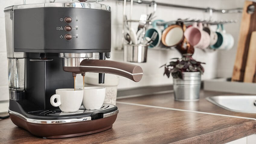 Coffeemaker with two cups  in interior of modern kitchen closeup.