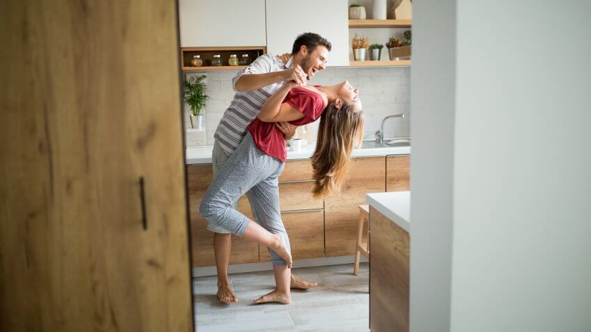 Two Lovers dancing in the kitchen.
