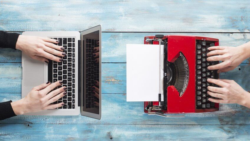 Old typewriter and laptop.
