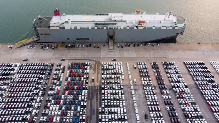 Aerial view cargo ship of business logistic sea freight, New Cars produced by year up in the port for Cargo ship and Cargo import-export around in the world - Image.
