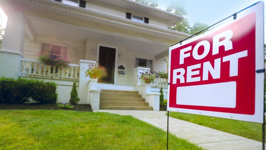 for sale sign in front yard