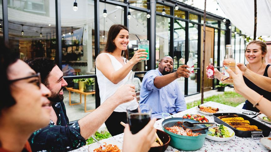 Group of diverse friends enjoying summer party together.