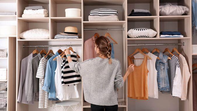 girl organizing large closet