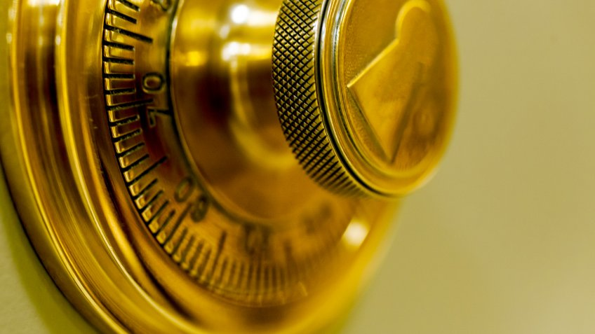 Combination safe lock, in golden duotone.