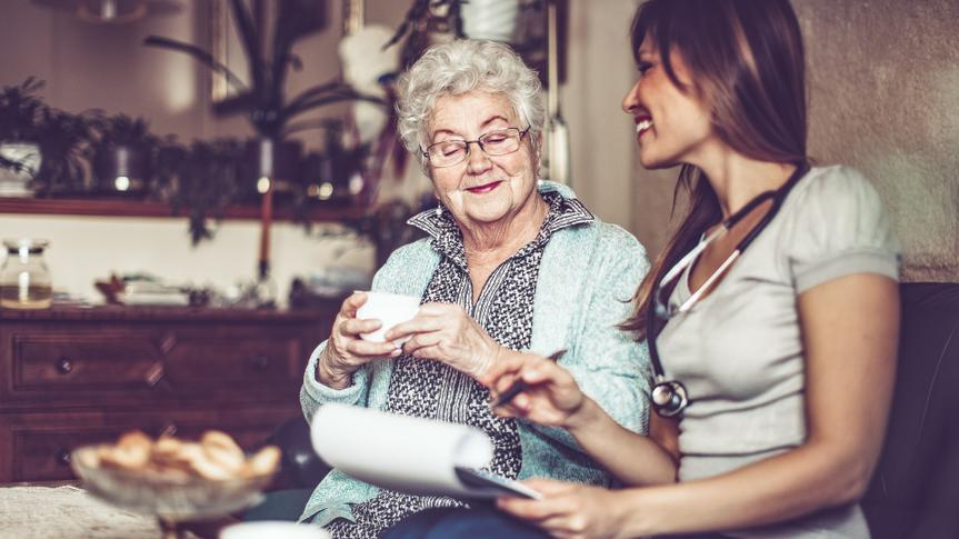 Social worker is visiting a senior woman in her own apartment.