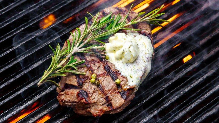 steak cooking on fire - Image.