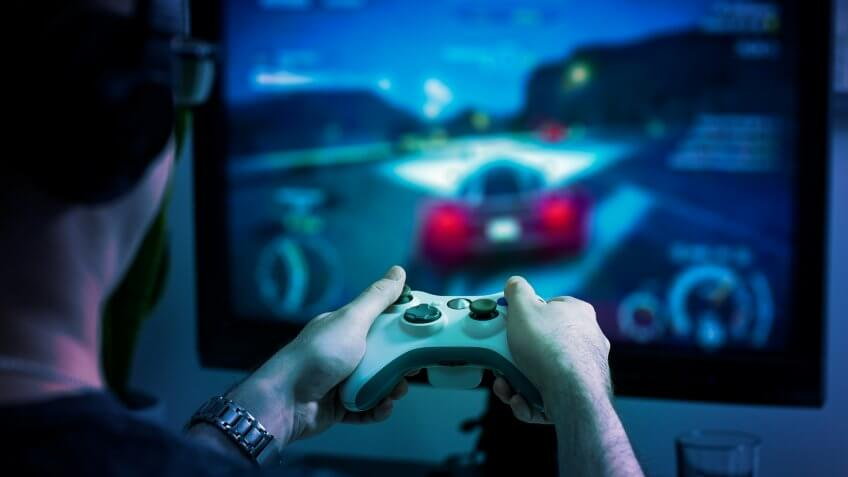 guy playing on gaming console