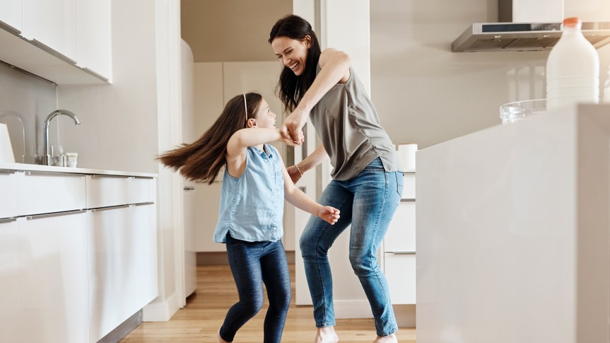 Shot of an adorable little girl dancing with her mother at home.